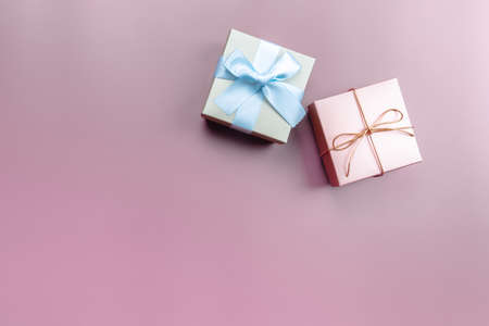 Two gift box on pink background for special day