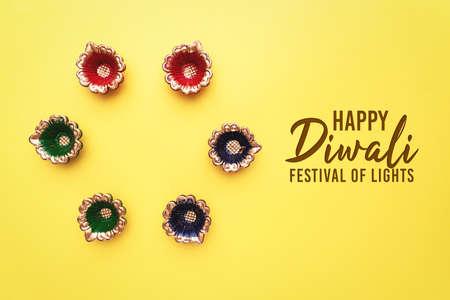 Happy Diwali - Clay Diya lamps lit during Dipavali, Hindu festival of lights celebration. Colorful traditional oil lamp diya Zdjęcie Seryjne