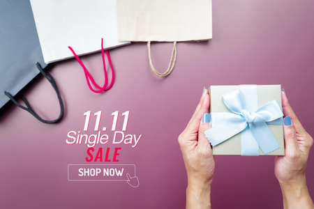 woman hand holding gift box and shopping bag for 11.11 single day sale