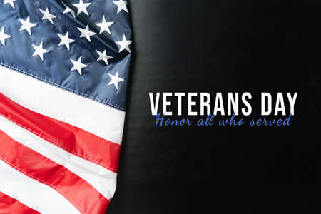 Veterans day. Honoring all who served. American flag on black background.