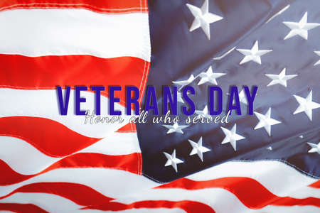 Veterans day. Honoring all who served. American flag waving in the wind.