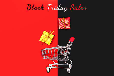 Black Friday sale concept, shopping cart and gift box, year-end sale Stock Photo