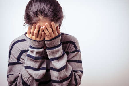 depressed women hand cover the crying face, human rights day concept