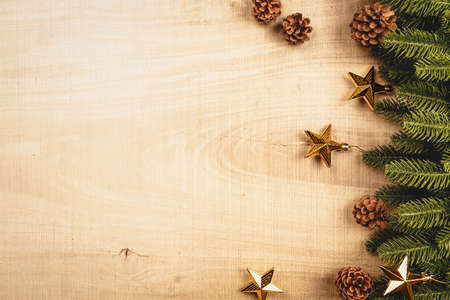 Christmas ball and pine tree with xmas decoration on wooden background 版權商用圖片