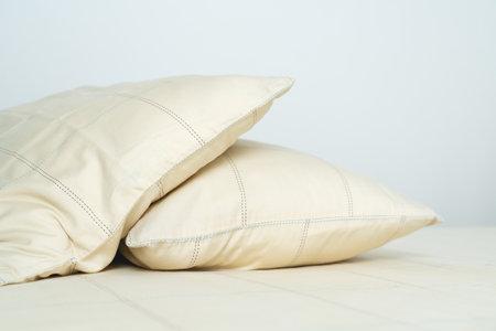 couple comfortable soft yellow pillows on bed 版權商用圖片