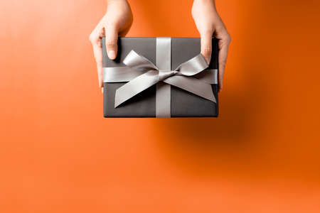 young woman hand with a gift box offer to receiver