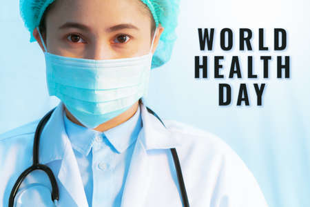 World Health Day concept,  virus stop infection. young female doctor wearing mask with stethoscope against infectious diseases and flu. Banco de Imagens