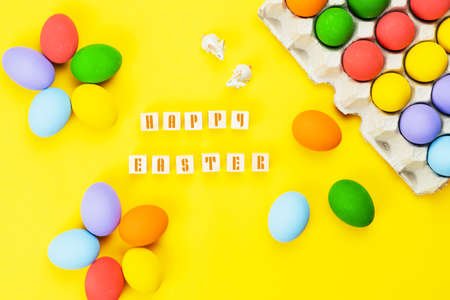 Easter day little Bunny rabbit with decorated eggs on yellow background
