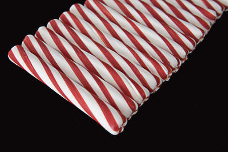 Peppermint Sticks Laying in a Row Stock Photo - 12621686