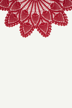 doily: Red Crocheted Doily on White Linen Background Stock Photo
