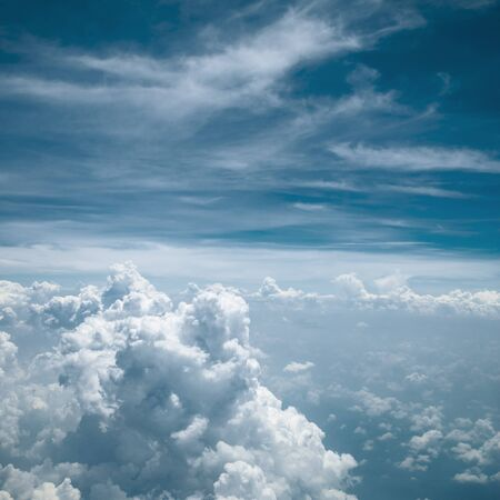 Fluffy cloud in bright blue sky view from above in day time, freedom concept. Stok Fotoğraf