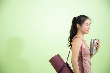 Smile happily Asian woman yoga instuctor in studio with equipments, healthy and wellbeing lifestyles concept with copy space. Stockfoto