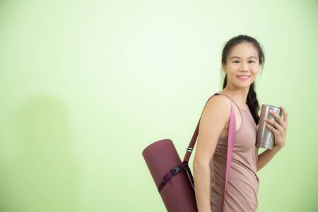 Smile happily Asian woman yoga instructor in studio with equipments, healthy and wellbeing lifestyles concept with copy space.
