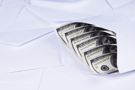 money in an envelop with white background photo