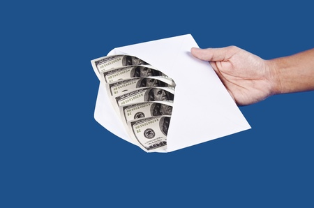 envelop: holding an envelop with money in Stock Photo
