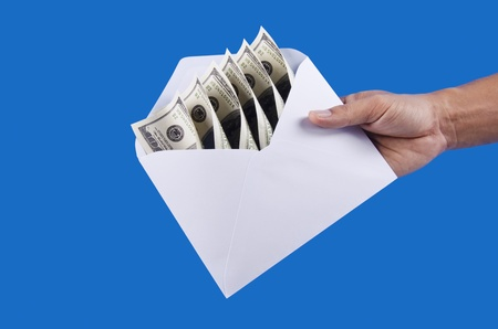 a hand is holding an envelop  Stock Photo