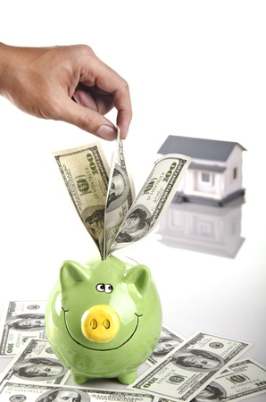 putting money in your piggy bank Stock Photo - 11861389