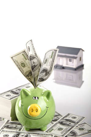 saving your money in piggy bank for a dreamed home photo