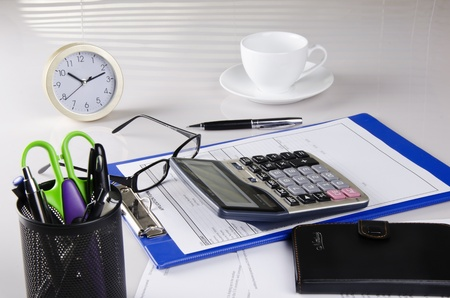 a calculator on a desk photo
