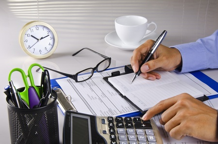 calculating and writing a note Stock Photo
