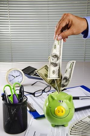 businessman save money in piggy bank photo