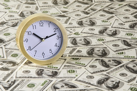 golden clock and money photo