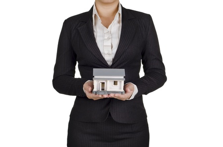 royalty free stock photos: a businesswoman hold a house in her hands Stock Photo