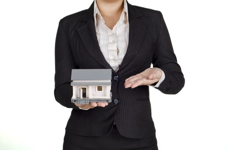 a woman real estate agent show a house photo