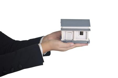 stock agency: una casa � offerred da un agente immobiliare