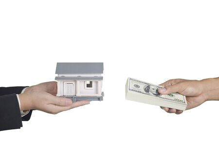 hands holding house: real estate transaction concept