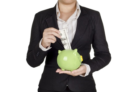 a businesswoman save money in piggy bank photo