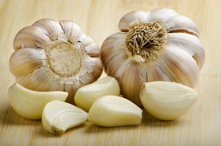 royalty free stock photos: 2 clusters of garlic and garlic cloves