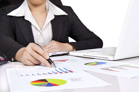 a business woman showing a business chart photo