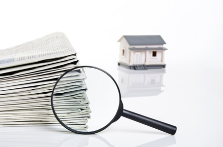 searching for a home on newspapers