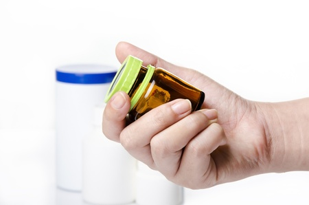 holding a medicine bottle Stock Photo - 13152550