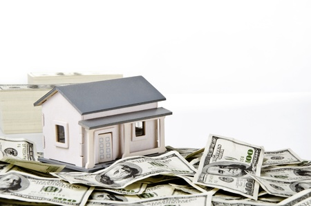 us currency: Model house on hundred of US dollars Stock Photo