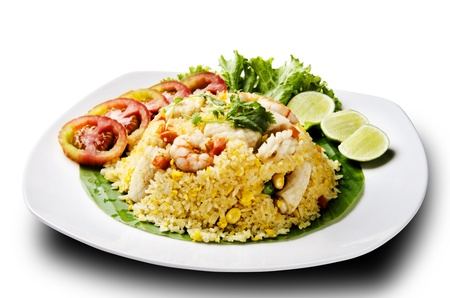 seafood fried rice with tomato and lemon Stock Photo