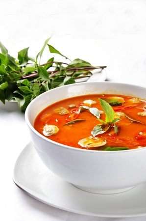 tomyam seafood with herb photo