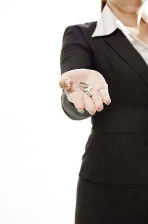 hand key: business woman standing and giving a key Stock Photo