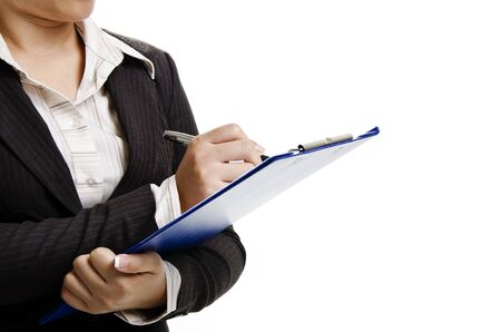 a businesswoman writing on note pad and stand on the left hand side