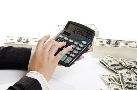 pressing calculator as bank job Stock Photo