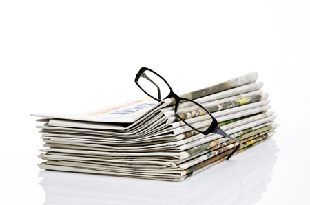 broadsheet: glasses on newspaper with white background Stock Photo