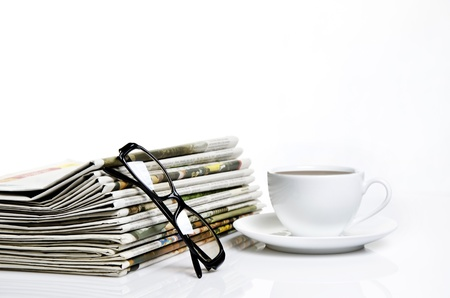 glasses and newspapers with a cup of coffee Stock Photo