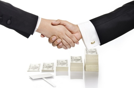 business people shaking hand over growing money and empty sign photo