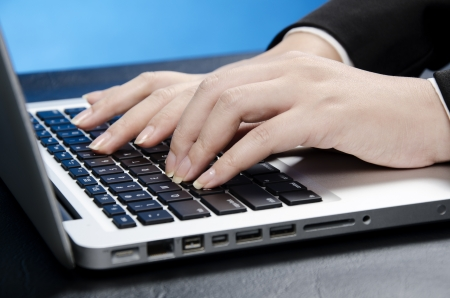 data entry: female fingers on computer keyboard