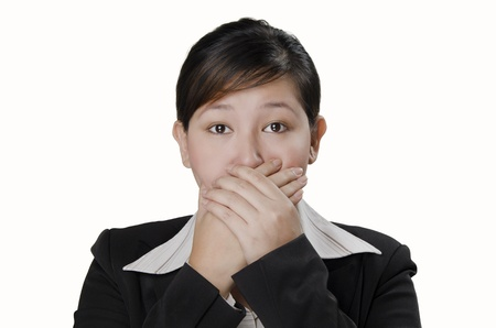 a businesswoman closed her mouth with her hands
