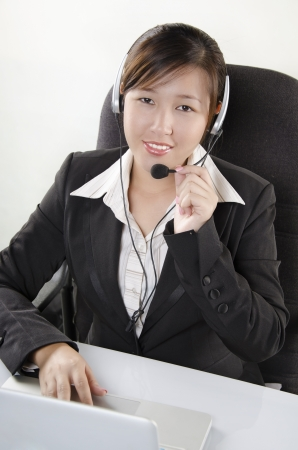 Beautiful customer service agent in call center photo