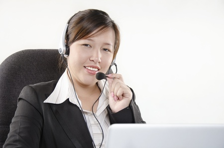 A beautiful customer service with headset Stock Photo - 14739665