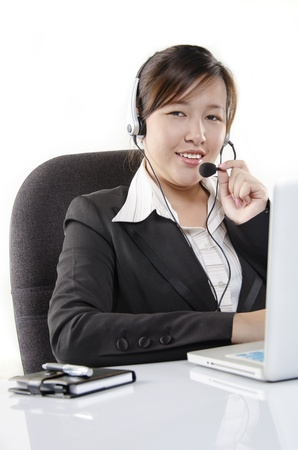 Pretty service agent smiling while working Stock Photo - 14739667