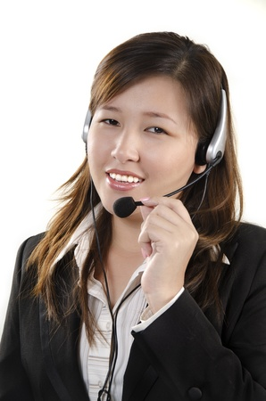 Smiling female service agent with headset photo